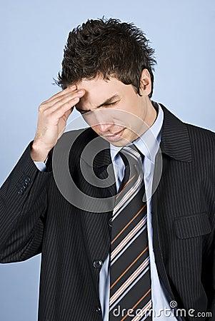 Young executive with headache
