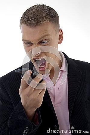 Young executive shouting on mobile
