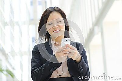 Young executive Texting
