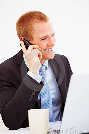 Young executive using a cellphone, looking away