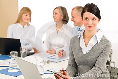 Young executive woman use phone during meeting