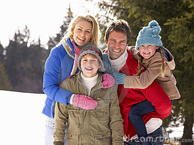 Young Family  In Alpine Snow Scene