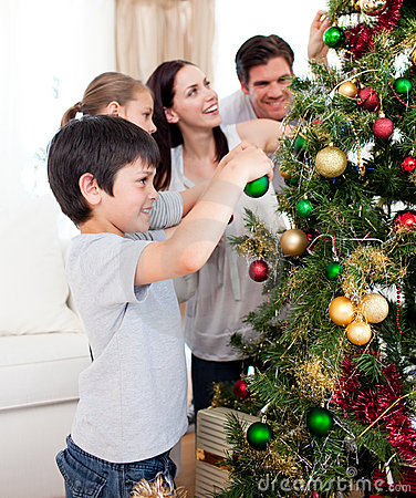 Young family decorating a Christmas tree