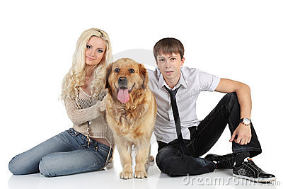 A young family with a dog sitting on floor