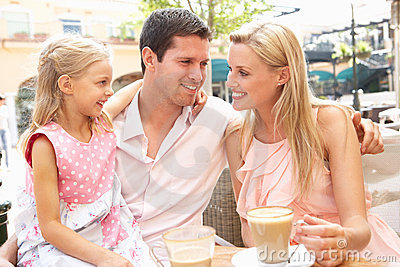Young Family Enjoying Cup Of Coffee