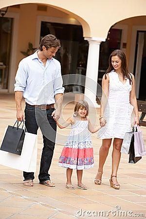 Young Family Enjoying Shopping Trip