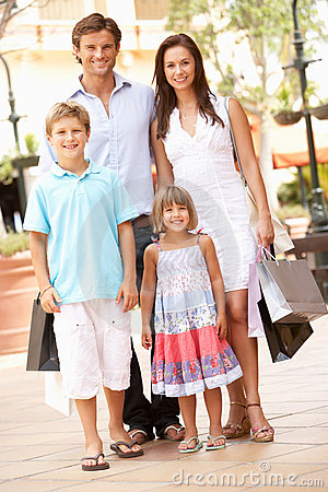 Young Family Enjoying Shopping Trip