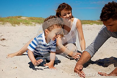 Young Family Enjoying Summer on a Beach