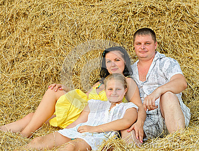A young family, father, mother and daughter
