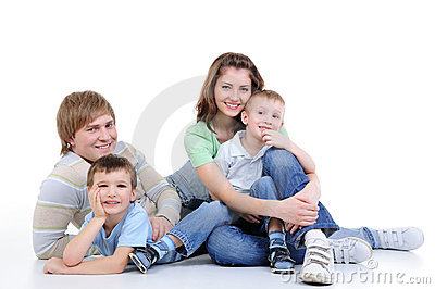 Young family of four family enjoing together