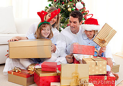 Young Family Having Fun With Christmas Gifts Royalty Free #1: young family having fun christmas ts