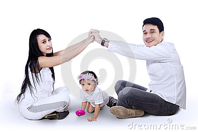 Young family making the home sign