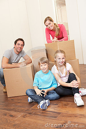 Young family on moving day looking happy