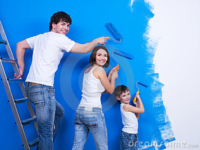 Young family painting the wall