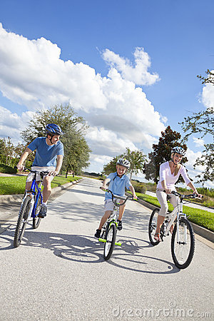 Young Family Parents and Boy Son Cycling