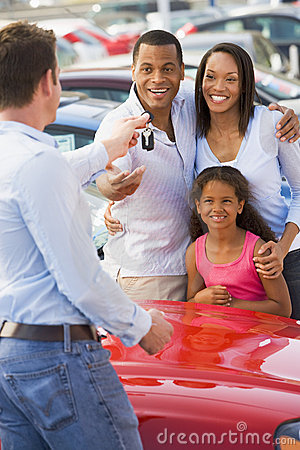 Free Young Family Picking Up New Car Stock Photography - 5096222