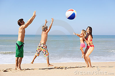 Young family play on beach