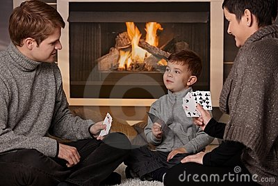 Young family playing card game