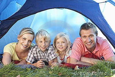 Young family poses in tent
