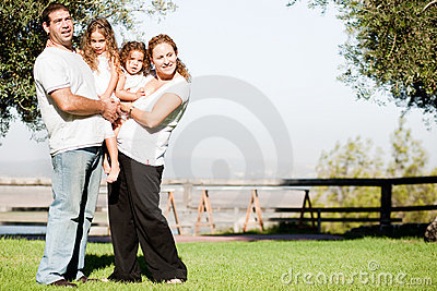 Young family posing for a picture