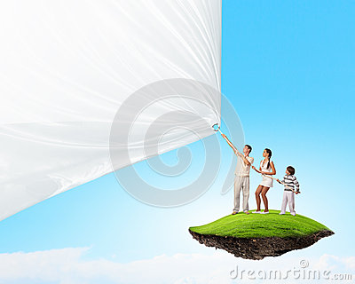 Young family pulling banner