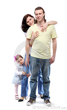 Young family are standing in embrace
