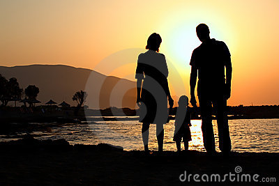 Young family at sunset