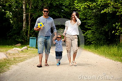 Young Family on Their Way to a Summer Destination