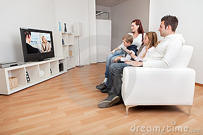 Young family watching TV at home