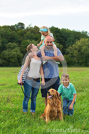 Free Young Family With Their Pet Dog, Golden Retriever Royalty Free Stock Image - 62039096
