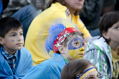 Young fans watching football match Editorial Image