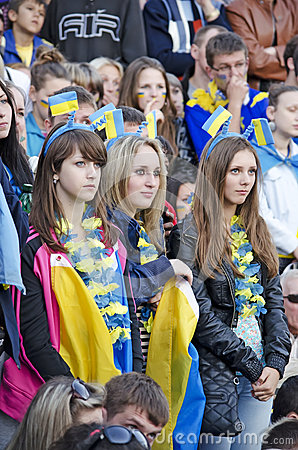 Young fans watching football match Editorial Stock Photo