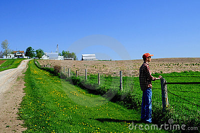 Young farmer at his fence