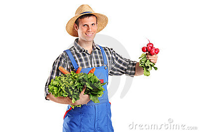 Young farmer holding vegetables