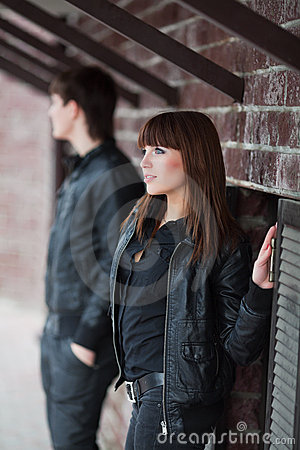 Free Young Fashion Couple Flirting At The Wall Stock Images - 17688704
