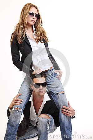 Young fashion couple posing in studio