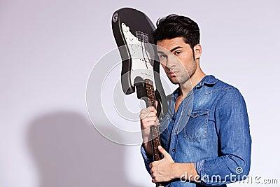 Young fashion guitarist