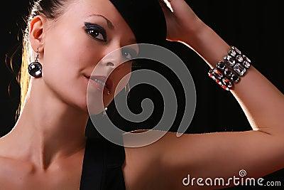 Young fashion model with diamond bracelet