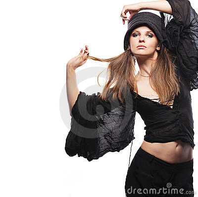 Young fashion model posing on white background.