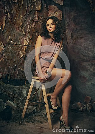 Free Young Fashion Model With Creative Make Up Sitting On A Stool In Royalty Free Stock Image - 106615126