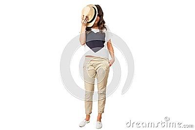 Young fashionable brunette hiding face
