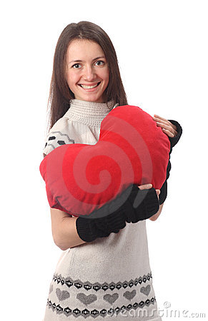 Young fashionable woman holding red heart