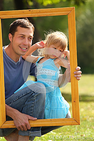Father with his daughter in the frame