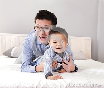 Young father play with his son boy
