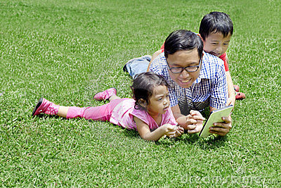 Young father playing with a digital tablet