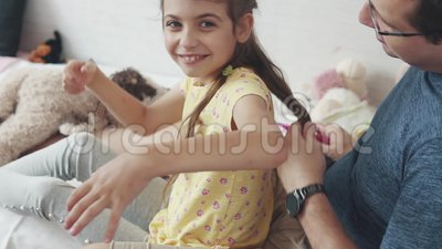 Young Father Spends Time With His Little Daughter. Dad Plaits Pigtails, Plays With Her And Fools Around Stock Video - Video of little, happy: 120026263