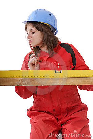 Young female apprentice in red overall