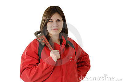 Young female apprentice in with screscent wrench