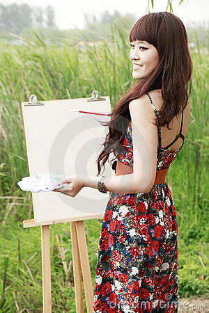 Young female artist outdoor