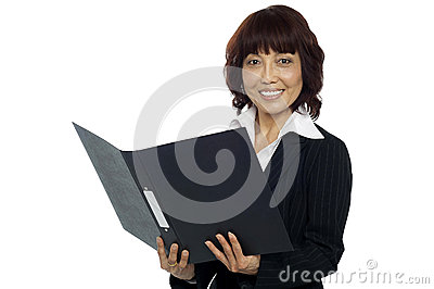 Young female asian boss going through the file